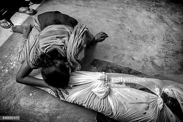 A relative grieves after identifying the body of a loved one killed when collapse of the eightstory building RanaPlaza in Savar Dhaka Bangladesh 25...