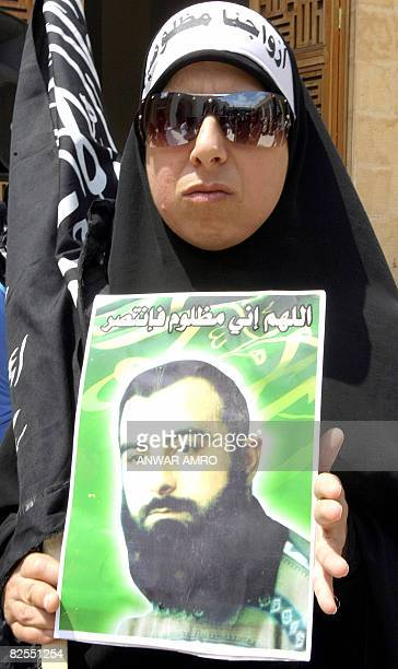 A relative holding a poster of a loved one protests on August 15 2008 inside the alOmari alKabir mosque in downtown Beirut calling for the freeing of...