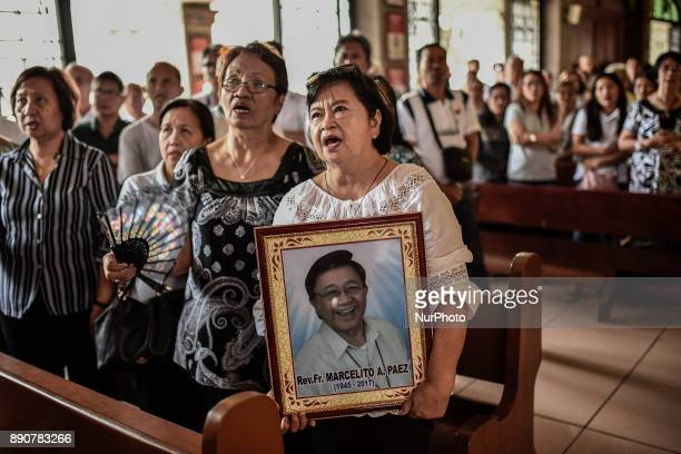 A relative holds a picture of activist priest Fr Marcelito quotTitoquot Paez during his funeral in San Jose Nueva Ecija north of Manila Philippines...