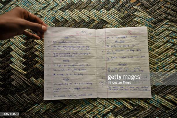 A relative holds the notebook of the rapemurder victim at Jhansa village on January 16 2018 in Jind India A Class 12 student is the prime suspect in...