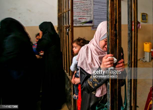 A relative mourns during the funeral of Maria alGazali a fourmonthold Palestinian baby in Gaza City on May 6 2019 Four people were killed in Israel...
