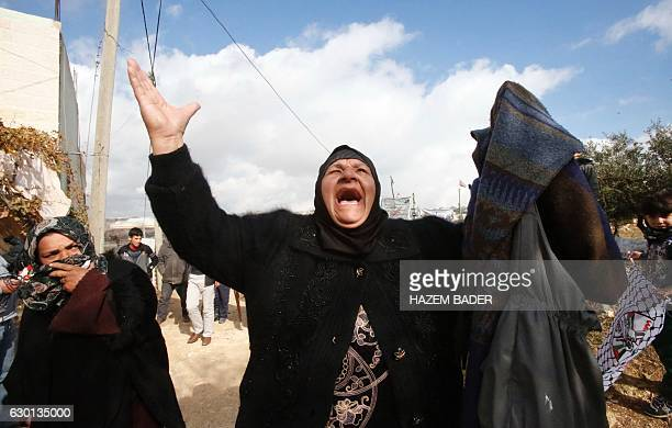 A relative mourns during the funeral of Sara Daoud a Palestinian woman who was killed while allegedly carrying out an attack on Israelis in the West...