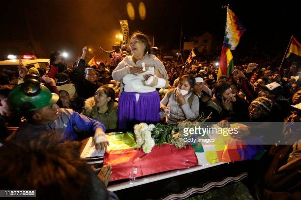 Relative mourns of one of the four farmers killed in a clash with the police in Sacaba during a vigil held in the streets on November 15, 2019 in...