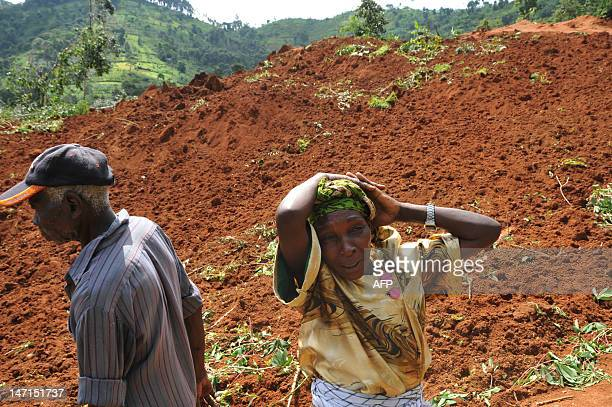 A relative mourns victims of the landslide in Bududa district about 200 kms east of Kampala on June 27 2012 The landslide killed at least 18 people...