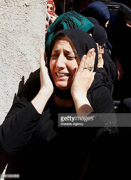 A relative of 17yearold Palestinian Mohammad Abu Hashsash who was killed by Israeli soldiers at AlFawwar refugee camp mourns during a funeral...