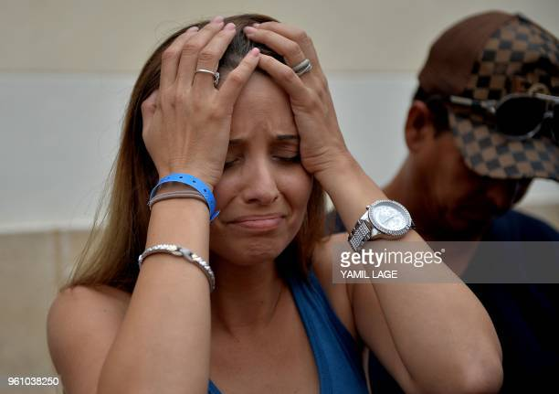 TOPSHOT A relative of 19yearold Mailen Diaz Almaguer one of the survivors of the plane crash cries after receiving a medical report at the Calixto...