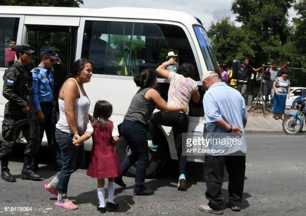 A relative of a bus driver killed by gang members for refusing to pay them a war tax cries nexto to the minibus in Tegucigalpa on July 18 2017 Public...