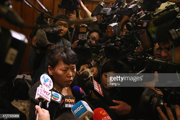 A relative of a Chinese passenger onboard Malaysia Airlines flight MH370 answer media question about the pensions inside relative area at Lido Hotel...