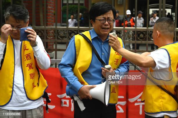 A relative of a drink driving victim speaks to the press outside parliament during a demonstration on March 29 2019 Taiwan plans to ramp up...