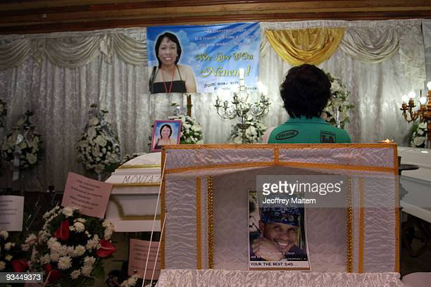 A relative of a journalist among 57 people massacred in the southern Philippine town of Ampatuan in Maguindanao is seen at a wake held for the...