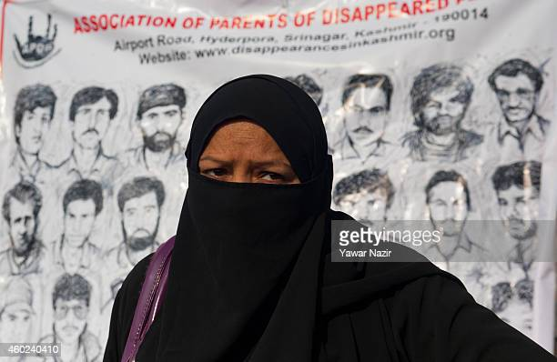 A relative of a missing person attends a protest demonstration organized by the Association of Parents of Disappeared Persons to mark World Human...
