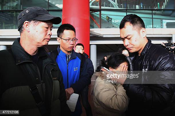 Relative of a passenger onboard Malaysia Airlines flight MH370 cries at Beijing International Airport March 8, 2014 in Beijing, China. Malaysia...