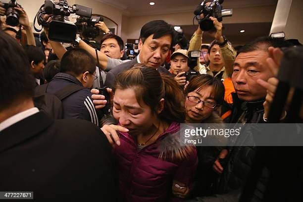 Relative of a passenger onboard Malaysia Airlines flight MH370 cries at Lidu Hotel on March 8, 2014 in Beijing, China. Malaysia Airlines Flight MH370...