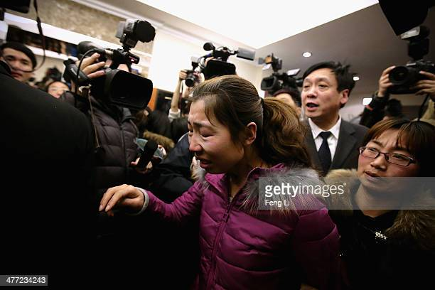 A relative of a passenger onboard Malaysia Airlines flight MH370 cries at Lidu Hotel on March 8 2014 in Beijing China Malaysia Airlines Flight MH370...