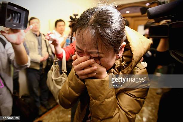Relative of a passenger onboard Malaysia Airlines flight MH370 cries out at a local hotel where families are gathered on March 9, 2014 in Beijing,...