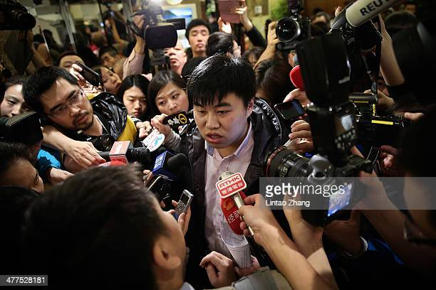 A relative of a passenger onboard Malaysia Airlines flight MH370 answers media questions at Lido Hotel on March 10 2014 in Beijing China Possible...