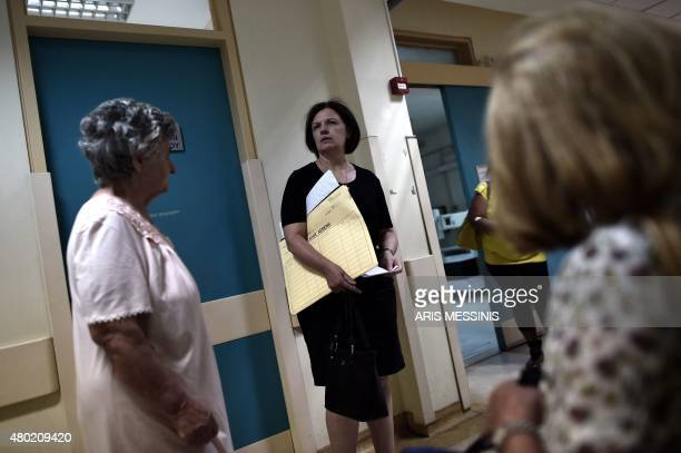 A relative of a patient stands in a corridor in an Athens hospital on July 8 2015 With expectations of a Greek exit from the eurozone gathering pace...