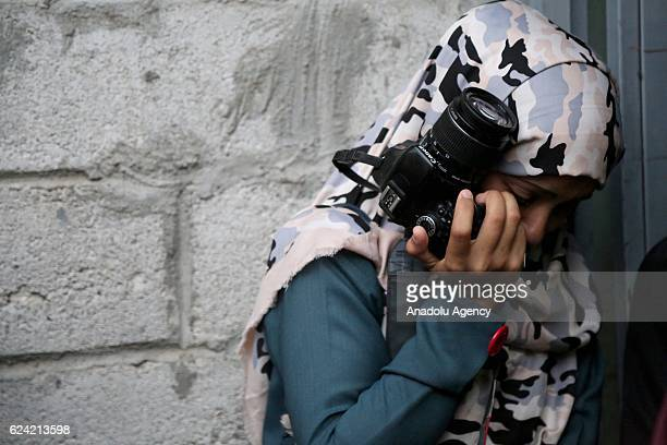 Relative of a photojournalist Evab ez-Zebiri who was killed after the bomb exploded which had put into a disused building by Houthis, mourns in front...