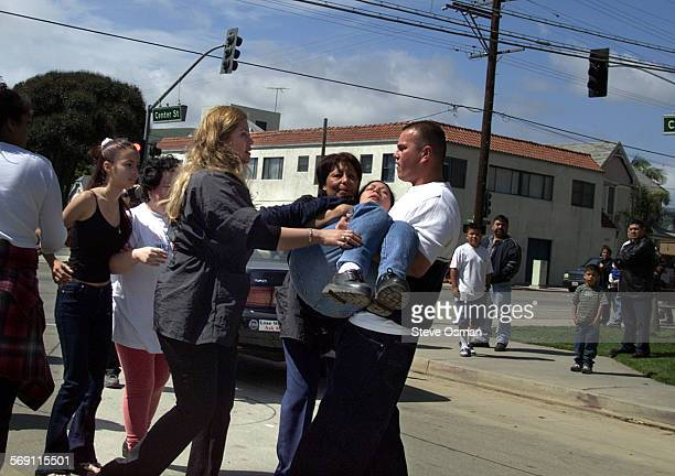 01–04–07 –– A relative of a shooting victim is carried away after fainting A relative of a shooting victim is helped from the scene after fainting...