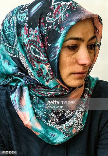 A relative of a victim cries at forensic building as she wait for body of her relative on March 14 2016 in Ankara the day after a suicide car bomb...