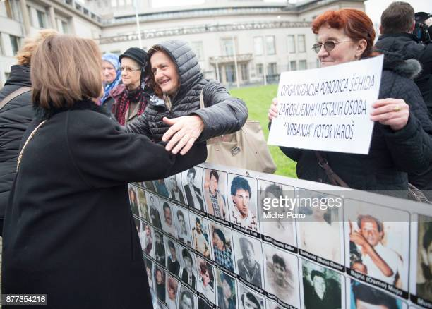A relative of a victim is hugged outside the court before former Bosnian military chief Ratko Mladic appears for the pronouncement of the Trial...