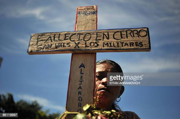 A relative of a victim of Guatemala's civil war takes part in a ceremony on February 25 2009 to commemorate the 10th anniversary of the publication...