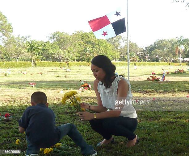 A relative of a victim of the 1989's US invasion to Panama to oust dictator Manuel Noriega pays a visit to her loved one buried in a common grave at...