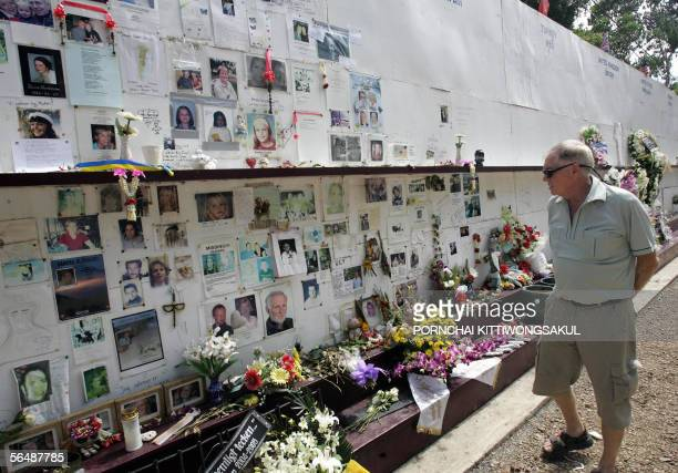 A relative of a victim of the 2004 Tsunami visits the memorial wall at Mai Khao cemetery in Phuket 26 December 2005 Thousands of Thais and foreigners...