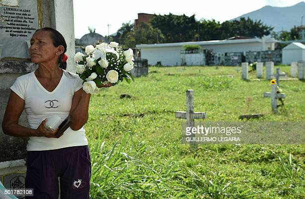 A relative of a victim of the armed conflict in Colombia waits to bury the remains of her loved one in the central cemetery of Villavicencio Meta...