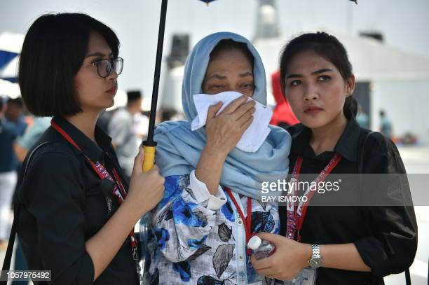 A relative of a victim of the illfated Lion Air flight JT 610 is given assistance as she grieves during a visit to the site of the crash in the Java...