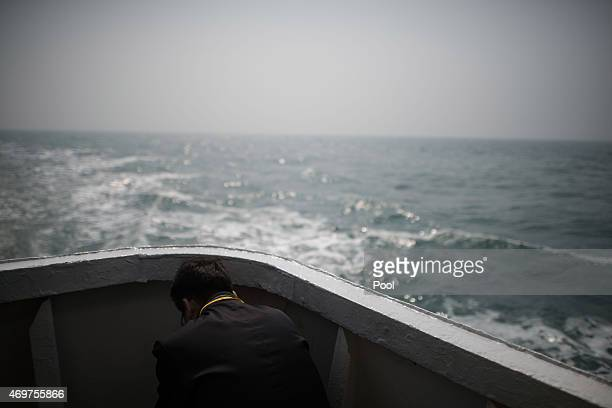 A relative of a victim of the Sewol ferry disaster sits on the deck of a boat during a visit to the site of the sunken ferry on April 15 2015 in...