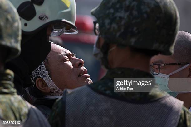 A relative of a victim weeps at the site of collapsed buildings on February 7 2016 in Tainan Taiwan A magnitude 64 earthquake hit southern Taiwan...
