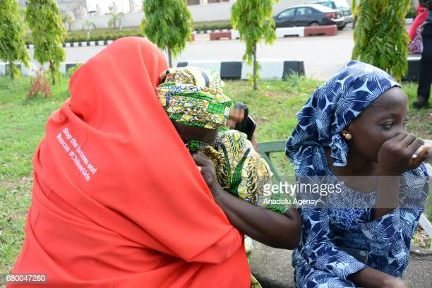 Relative of abducted girls gesture prior to a welcoming ceremony after the releasing 82 of school girls kidnapped by Boko Haram in Chibok back in...