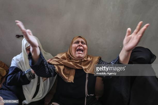 A relative of Ahmad Omar who was killed by Israeli soldiers on 18th of September mourns during his funeral ceremony at AlShati Palestinian refugee...