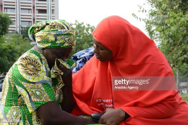 A relative of an abducted girl gestures prior to a welcoming ceremony after the releasing 82 of school girls kidnapped by Boko Haram in Chibok back...
