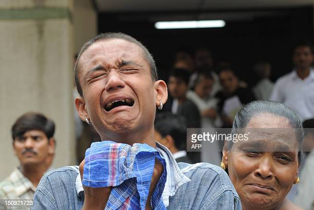 Relative of an undertrial Indian prisoner reacts inside a Trial Court compound in Ahmedabad on August 29 following a court decision. An Indian court...