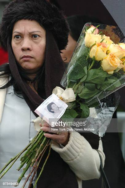 Relative of Balbina Soto De Rodriguez who was killed in the crash of American Airlines Flight 587 glares at a new house built at the crash site at...
