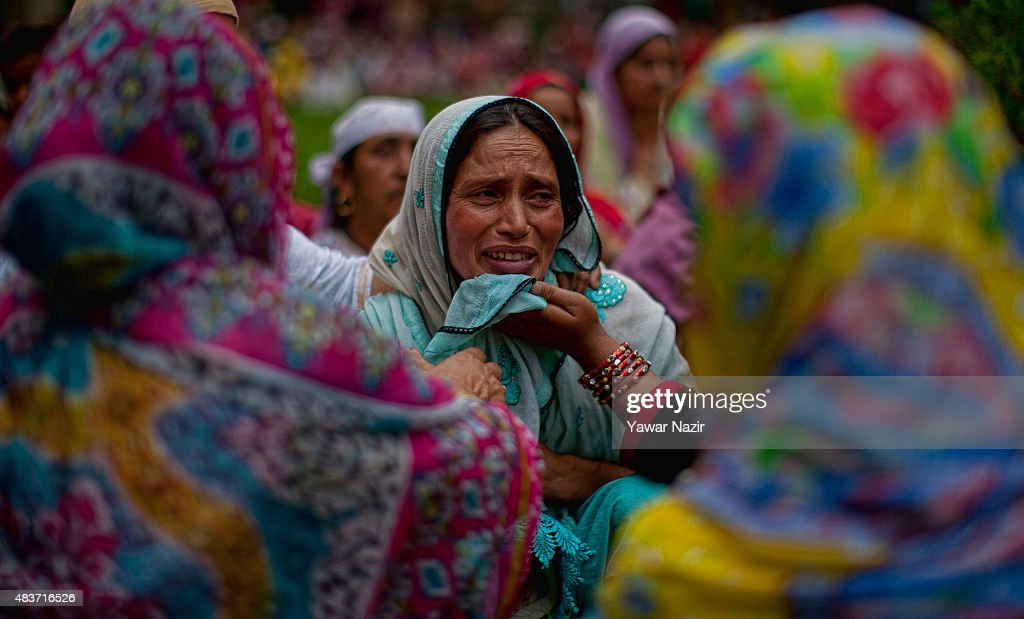 A relative of Bilal Ahmad Bhat, 23, a civilian who was allegedly shot dead by Indian paramilitary Border Security Force (BSF) mourns during his funeral on August 12, 2015 in Larkipur, 35 km (21 miles) south of Srinagar, the summer capital of Indian administered Kashmir, India. Hundreds of Kashmiris participated in the funeral of Bhat, who was killed by the Indian paramilitary BSF after they allegedly opened fire on the protestors who were protesting against the killing of two Lashkar-e-Taiba (Army of the Righteous) during a gun battle in Rakh-e-Lajura village of south Kashmir district on August 11, 2015. Lashkar-e-Taiba is one of the largest and most active militant organization operating in Indian administered Kashmir.