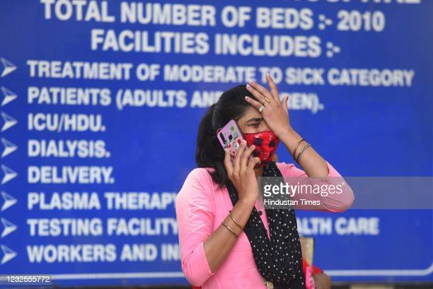Relative of Covid-19 patient cries as she waits for admission at Lok Nayak Jai Prakash hospital, on April 26, 2021 in New Delhi, India.