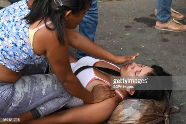 VALENCIA CARABOBO VENEZUELA A relative of detainees seen broken down outside the police station Relatives of detainees in the police headquarters of...
