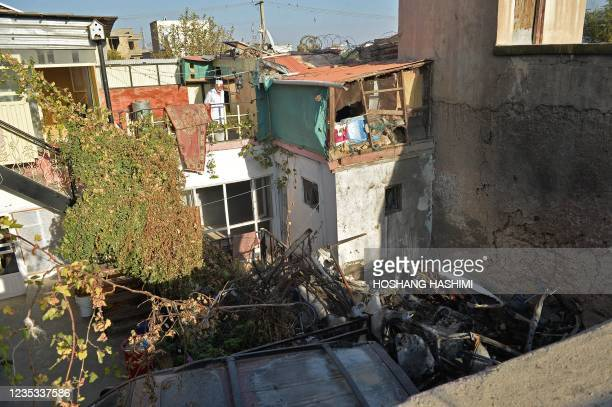 Relative of Ezmarai Ahmadi, looks at the courtyard of Ahmadi's house that was damaged in a US drone strike in the Kwaja Burga neighbourhood of Kabul...