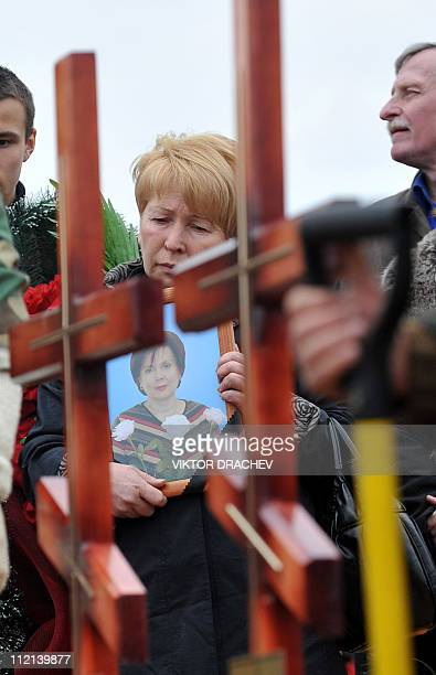 A relative of Galina Pikulik a victim of the Minsk metro bombing that killed 12 and wounded 200 on April 11 mourns during the funeral ceremony in...
