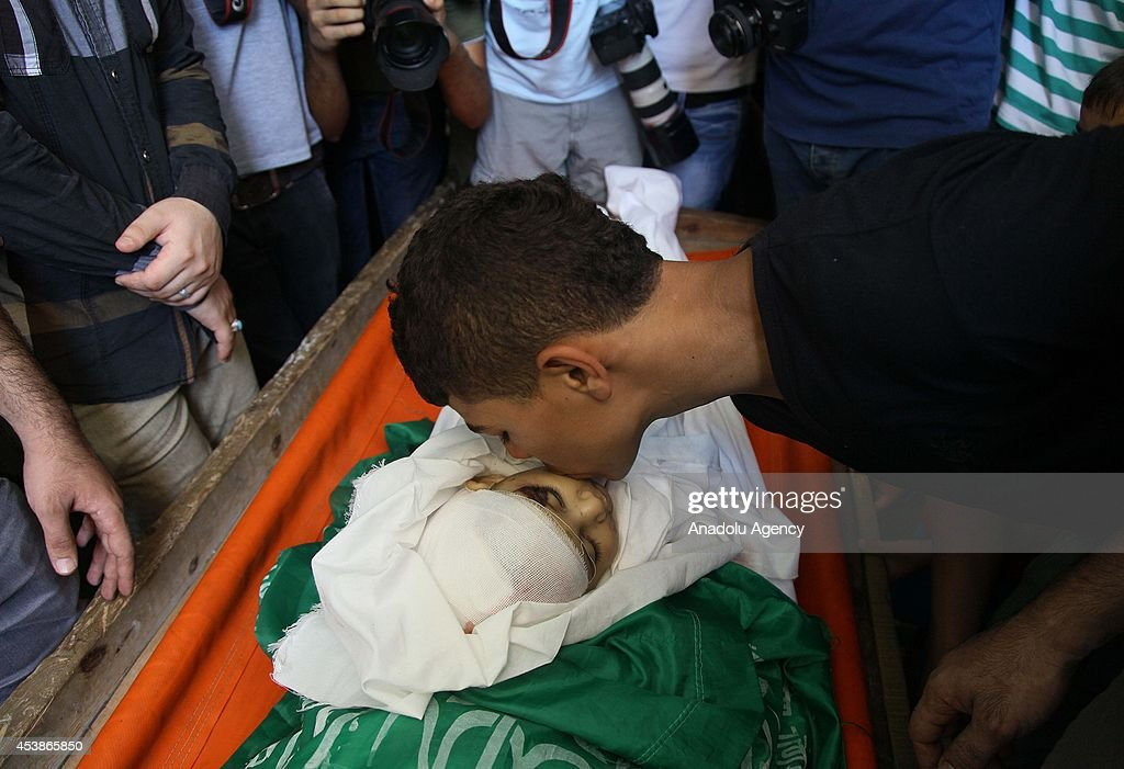 Funeral ceremony of Hamas commander's wife and son in Gaza : News Photo