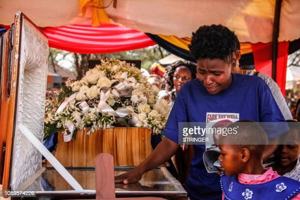 Relative of Japhet Nuru, the GSU officer who was killed in last week terror attack in Nairobi, reacts as she pays her respect during his burial...