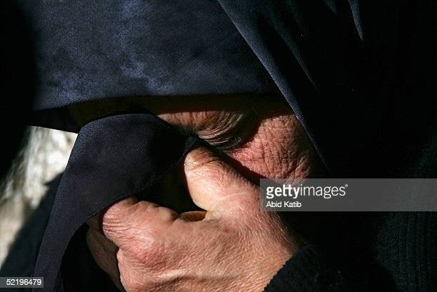A relative of one of the 15 dead Palestinian militants returned by Israel cries on February 14 2005 in Gaza City Gaza Strip Israel has handed over...