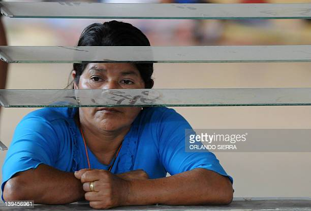 A relative of one of the 359 victims of the prison fire listens to Honduran President Porfirio Lobo during a meeting on February 21 2012 in...
