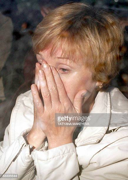 A relative of one of the crew members of the Russian minisubmarine AS28 Priz cries during their arrival at PetropavlovskKamchatsky port 07 August...