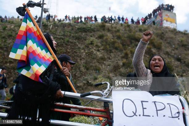 A relative of one of the victims killed during clashes with police at the Senkata fuel plant shouts slogans against interim president of Bolivia...