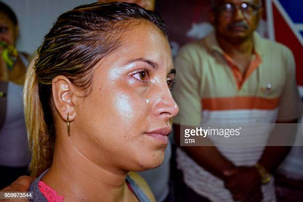 A relative of one of the victims of a plane crash is pictured at Holguin airport after a Cubana de Aviacion aircraft crashed after taking off from...