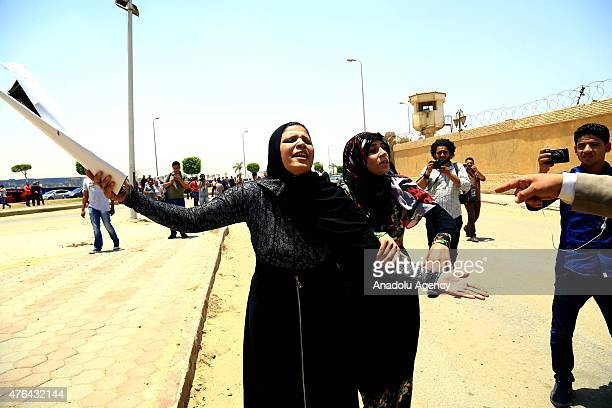 A relative of one of the victims of Port Said massacre cries after the trial of Port Said case in Cairo Egypt on June 9 2015 An Egyptian court on...